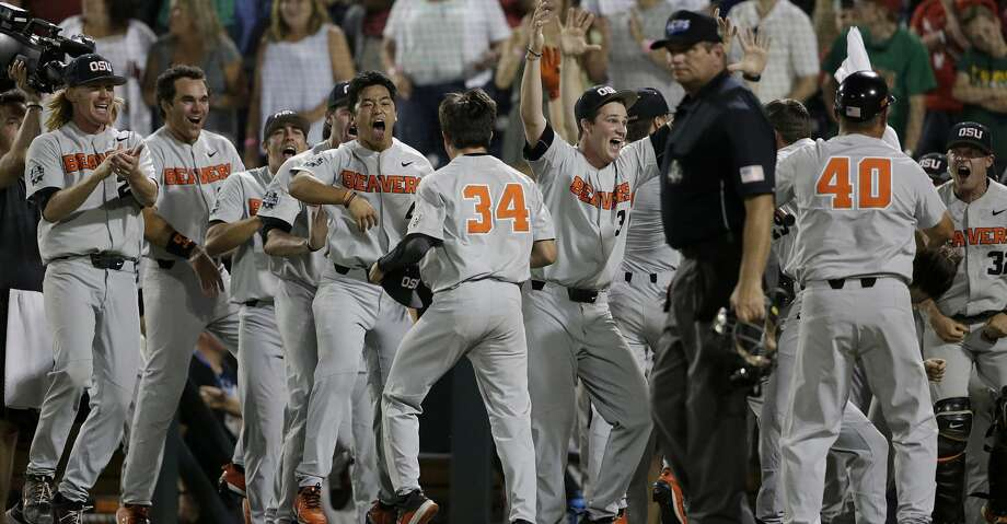 Oregon State players celebrate after a two-run home run by Trevor Larnach during the ninth inning of Game 2 of the NCAA College World Series baseball finals between Oregon State and Arkansas in Omaha, Neb., Wednesday, June 27, 2018. (AP Photo/Nati Harnik) Photo: Nati Harnik/Associated Press