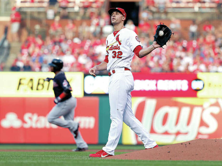 Cardinals starting pitcher Jack Flaherty (32) gets a new ball as Cleveland Indians' Edwin Encarnacion rounds the bases after hitting a solo home run in the second inning Wednesday's game at Busch Stadium.