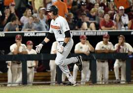 Oregon State's Trevor Larnach (11) celebrates his two-run home run against Arkansas during the ninth inning in Game 2 of the NCAA College World Series baseball finals in Omaha, Neb., Wednesday, June 27, 2018. (AP Photo/Ted Kirk)