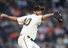 SAN FRANCISCO, CA - JUNE 27:  Madison Bumgarner #40 of the San Francisco Giants pitches against the Colorado Rockies in the second inning at AT&T Park on June 27, 2018 in San Francisco, California.  (Photo by Ezra Shaw/Getty Images)