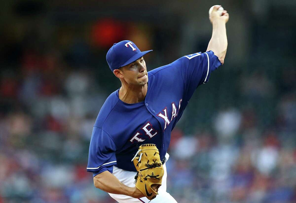 ARLINGTON, TX - JUNE 27: Mike Minor #36 of the Texas Rangers throws against the San Diego Padres in the first inning at Globe Life Park in Arlington on June 27, 2018 in Arlington, Texas. (Photo by Ronald Martinez/Getty Images)