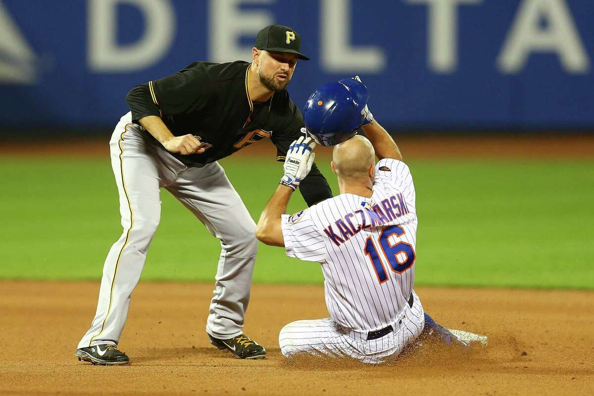 NEW YORK, NY - JUNE 27: Kevin Kaczmarski #16 of the New York Mets is tagged out by Jordy Mercer #10 of the Pittsburgh Pirates attempting to steal second base in the seventh inning at Citi Field on June 27, 2018 in the Flushing neighborhood of the Queens borough of New York City. (Photo by Mike Stobe/Getty Images)