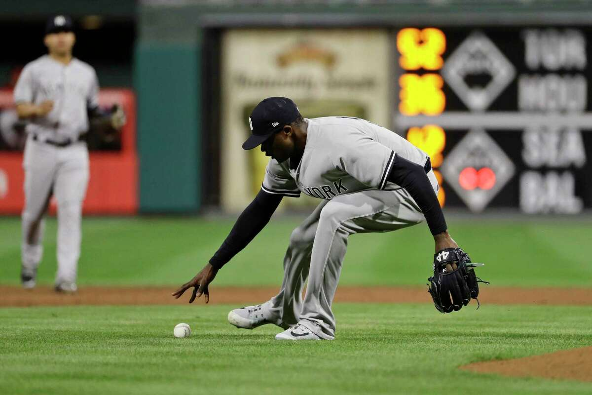 New York Yankees relief pitcher Domingo German picks up a grounder by Philadelphia Phillies' Aaron Altherr, who was out at first during the eighth inning of a baseball game Wednesday, June 27, 2018, in Philadelphia. Philadelphia won 3-0. (AP Photo/Matt Slocum)