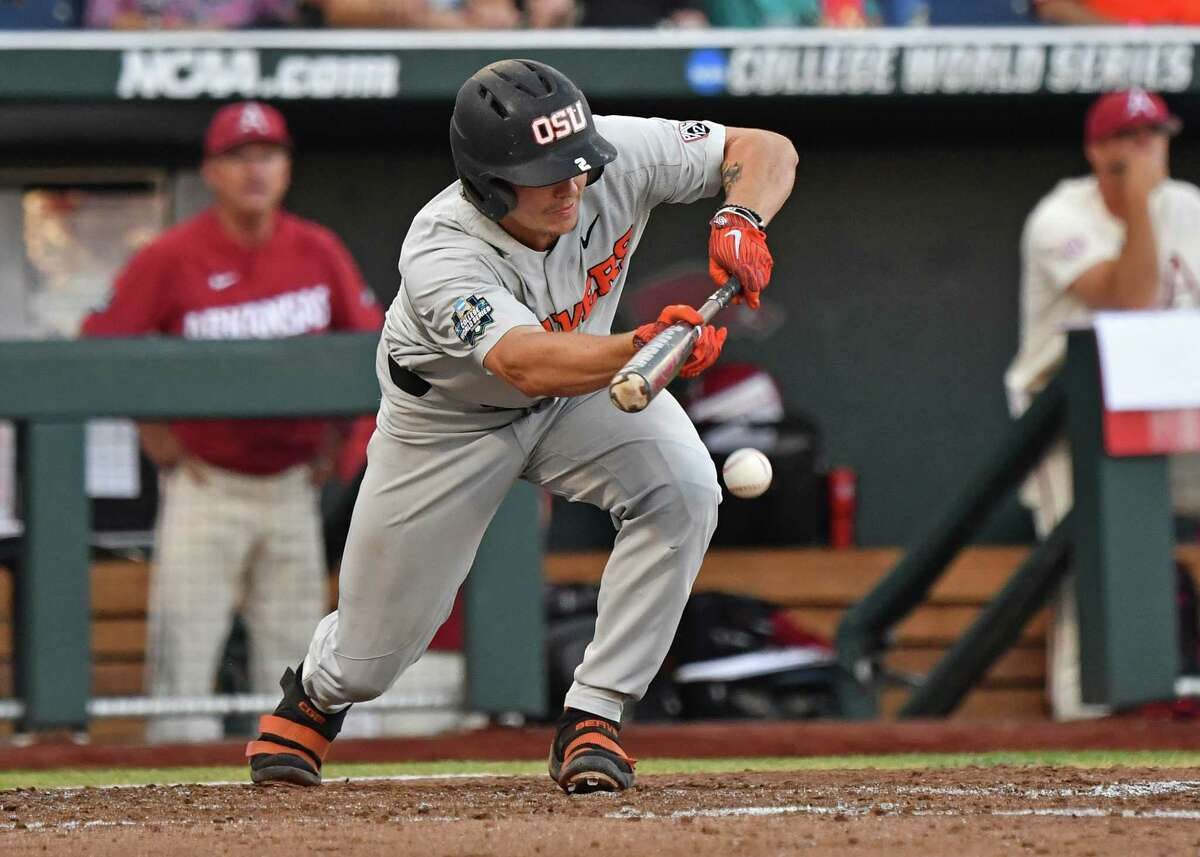 Omaha, NE - JUNE 27: Infielder Cadyn Grenier #2 of the Oregon State Beavers drives in a run with a squeeze bunt in the fifth inning against the Arkansas Razorbacks during game two of the College World Series Championship Series on June 27, 2018 at TD Ameritrade Park in Omaha, Nebraska. (Photo by Peter Aiken/Getty Images)