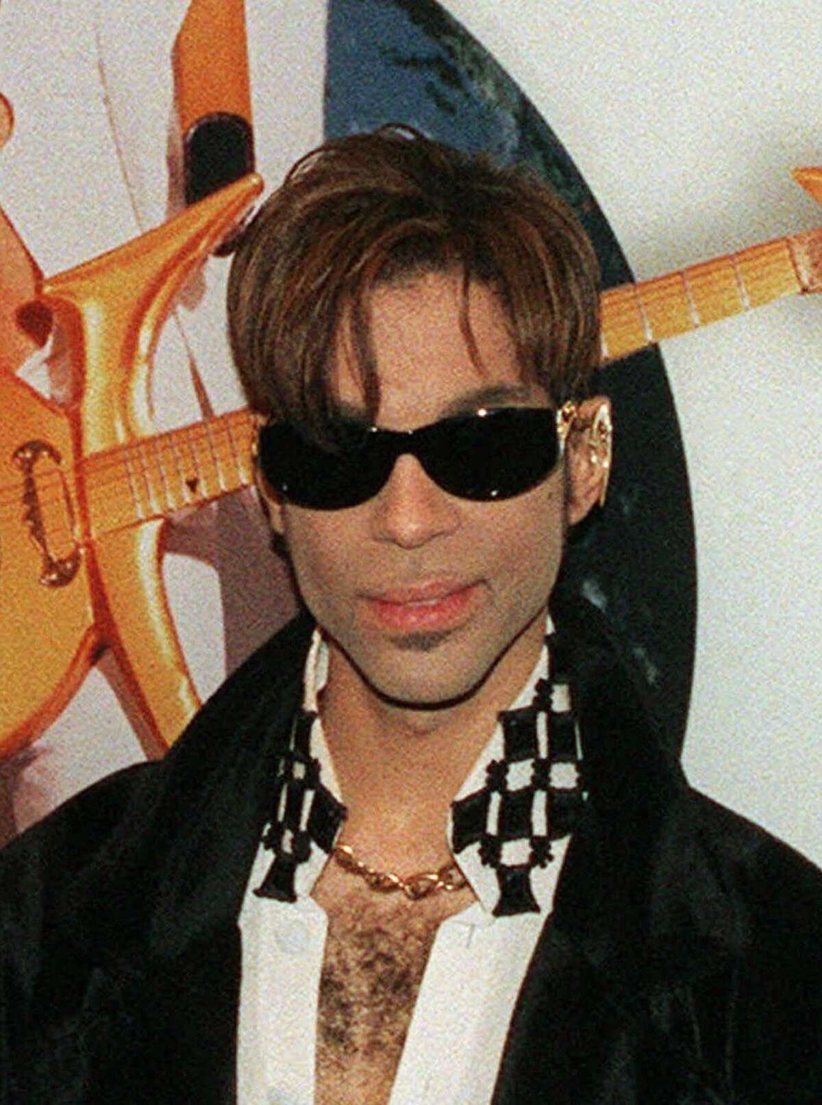 FILE--The artist formerly known as Prince is shown in this July 22, 1997, file photo. The artist formerly known as Prince donated $37,000 to the flood-ravaged town that bears his old name, Princeville. The musician contributed the money after reading articles about the devastation wreaked on the town of 2,100 by Hurricane Floyd. (AP Photo/Adam Nadel,file)