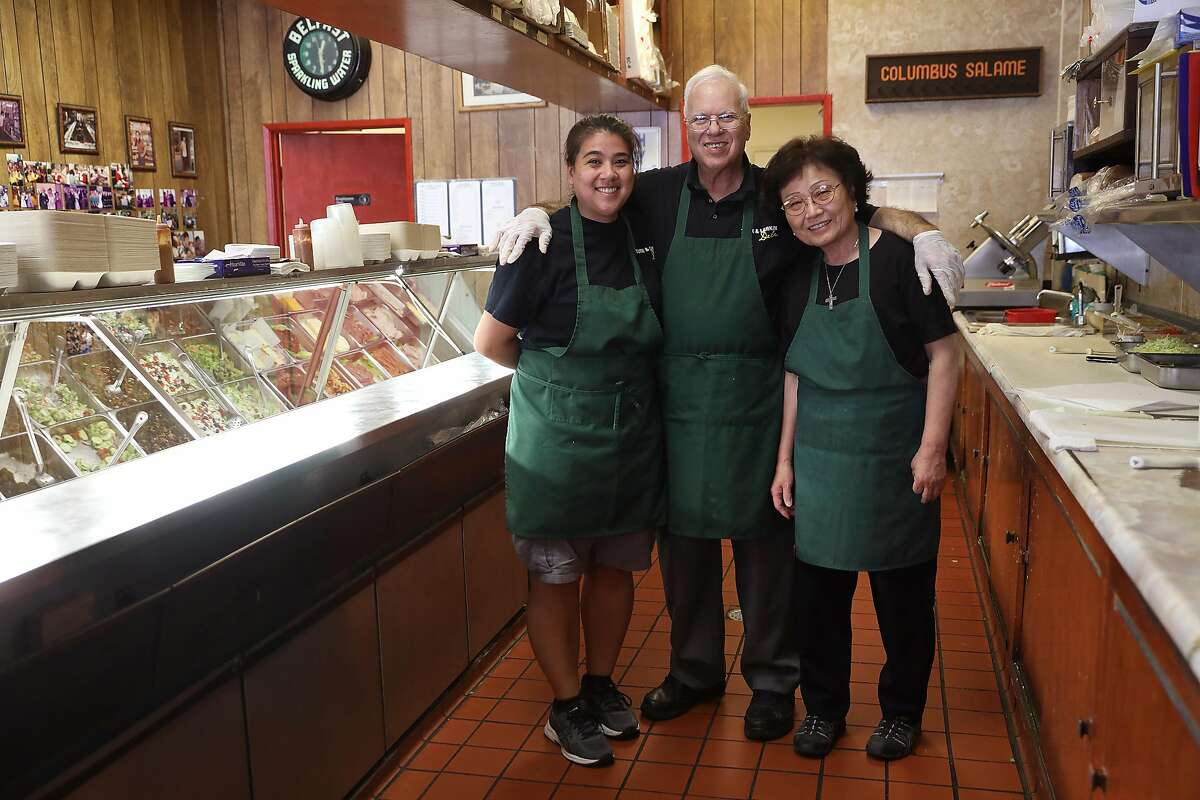 Rhonda Ramos (left) poses with her parents Mike and Jean Aburahma (right) at the Turk & Larkin Deli on Monday, June 25, 2018, in San Francisco, Calif.