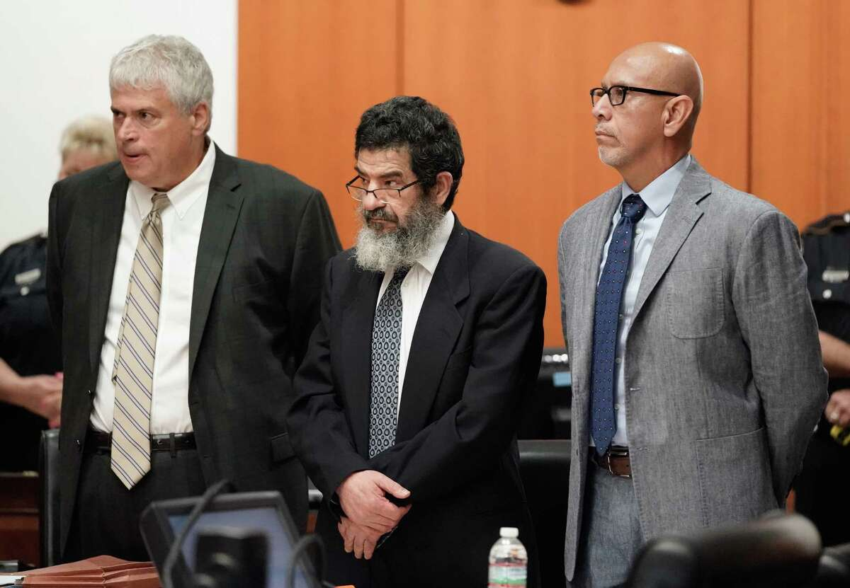 Ali Mahwood-Awad Irsan, center, is shown in court with his defense attorneys Allen Tanner, left, and Rudy Duarte, right, Monday, June 25, 2018. Irsan was charged with capital murder because his alleged crime involved multiple victims ?- his daughter?'s best friend, Gelareh Bagherzadeh, an Iranian medical student and activist, and his daughter?'s husband, Coty Beavers, 28. Both slayings, authorities said, were driven by the anger of Irsan, a conservative Muslim, over his daughter Nesreen?'s decision to marry Beavers, a Christian from Houston.( Melissa Phillip / Houston Chronicle )