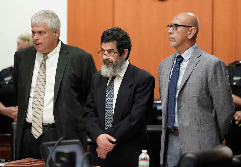 Ali Mahwood-Awad Irsan, center, is shown in court with his defense attorneys Allen Tanner, left, and Rudy Duarte, right, Monday, June 25, 2018. Irsan was charged with capital murder because his alleged crime involved multiple victims — his daughter's best friend, Gelareh Bagherzadeh, an Iranian medical student and activist, and his daughter's husband, Coty Beavers, 28. Both slayings, authorities said, were driven by the anger of Irsan, a conservative Muslim, over his daughter Nesreen's decision to marry Beavers, a Christian from Houston.( Melissa Phillip / Houston Chronicle ) Photo: Melissa Phillip, Staff / Houston Chronicle