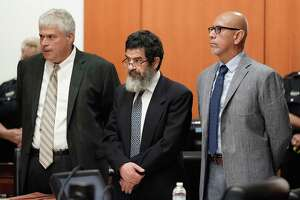 Ali Mahwood-Awad Irsan, center, is shown in court with his defense attorneys Allen Tanner, left, and Rudy Duarte, right, Monday, June 25, 2018. Irsan was charged with capital murder because his alleged crime involved multiple victims — his daughter's best friend, Gelareh Bagherzadeh, an Iranian medical student and activist, and his daughter's husband, Coty Beavers, 28. Both slayings, authorities said, were driven by the anger of Irsan, a conservative Muslim, over his daughter Nesreen's decision to marry Beavers, a Christian from Houston.( Melissa Phillip / Houston Chronicle )