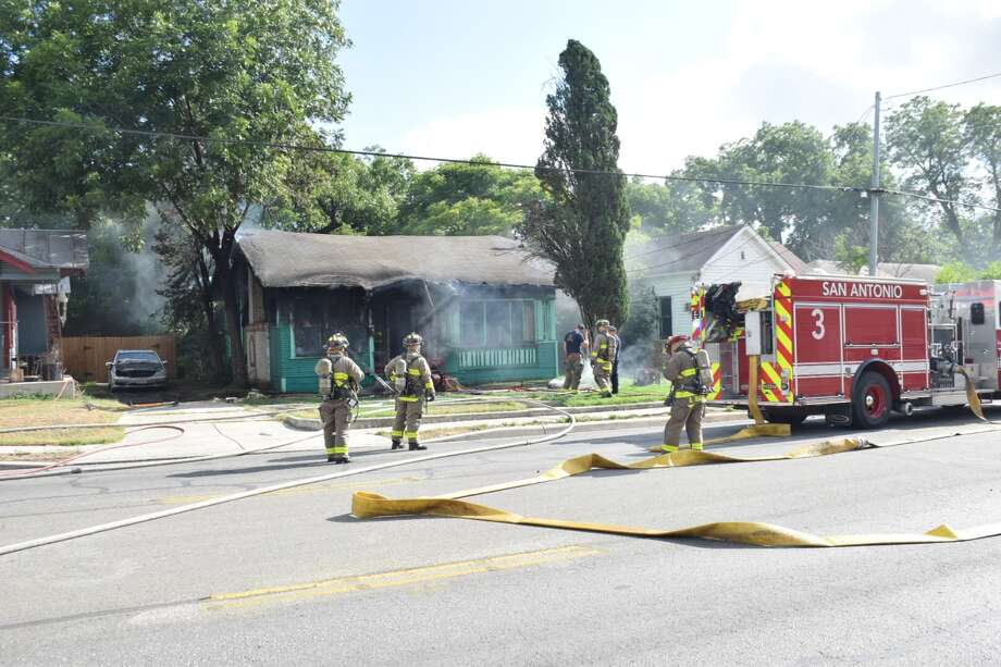 Firefighters responded to a blaze that injured one at a home in the 2200 block of East Houston Street in Thursday, June 28, 2018. Photo: Caleb Downs / San Antonio Express-News