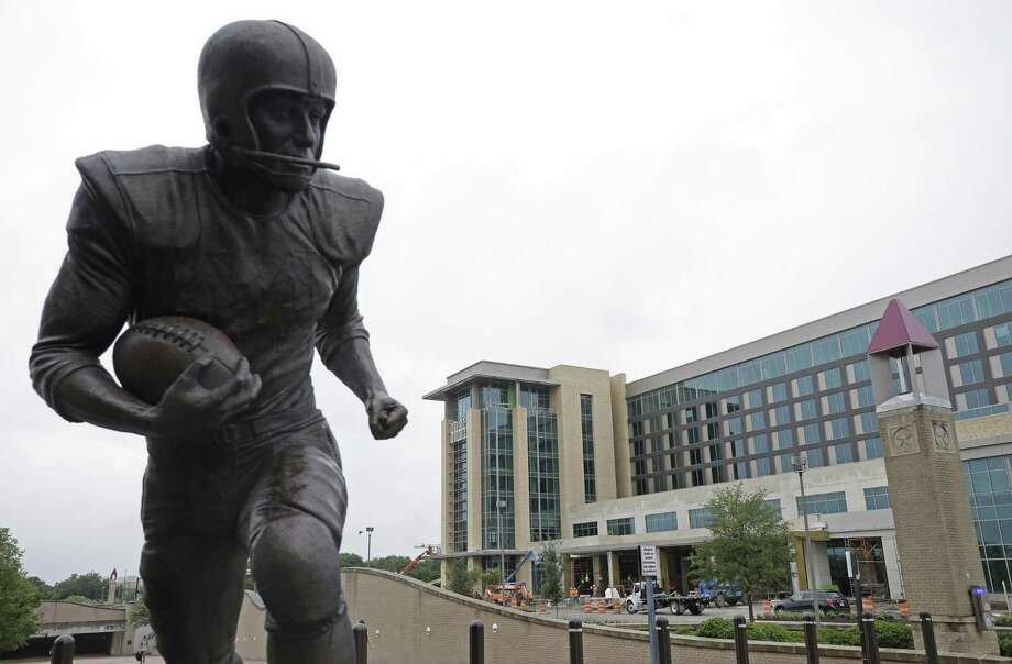 The statue honoring John Crow, winner of the 1957 Heisman Trophy, is shown across the street from the Doug Pitcock '49 Texas A&M Hotel and Conference Center under construction at Texas A&M University Wednesday, June 20, 2018, in College Station.  ( Melissa Phillip / Houston Chronicle ) Photo: Melissa Phillip, Staff / Houston Chronicle / © 2018 Houston Chronicle