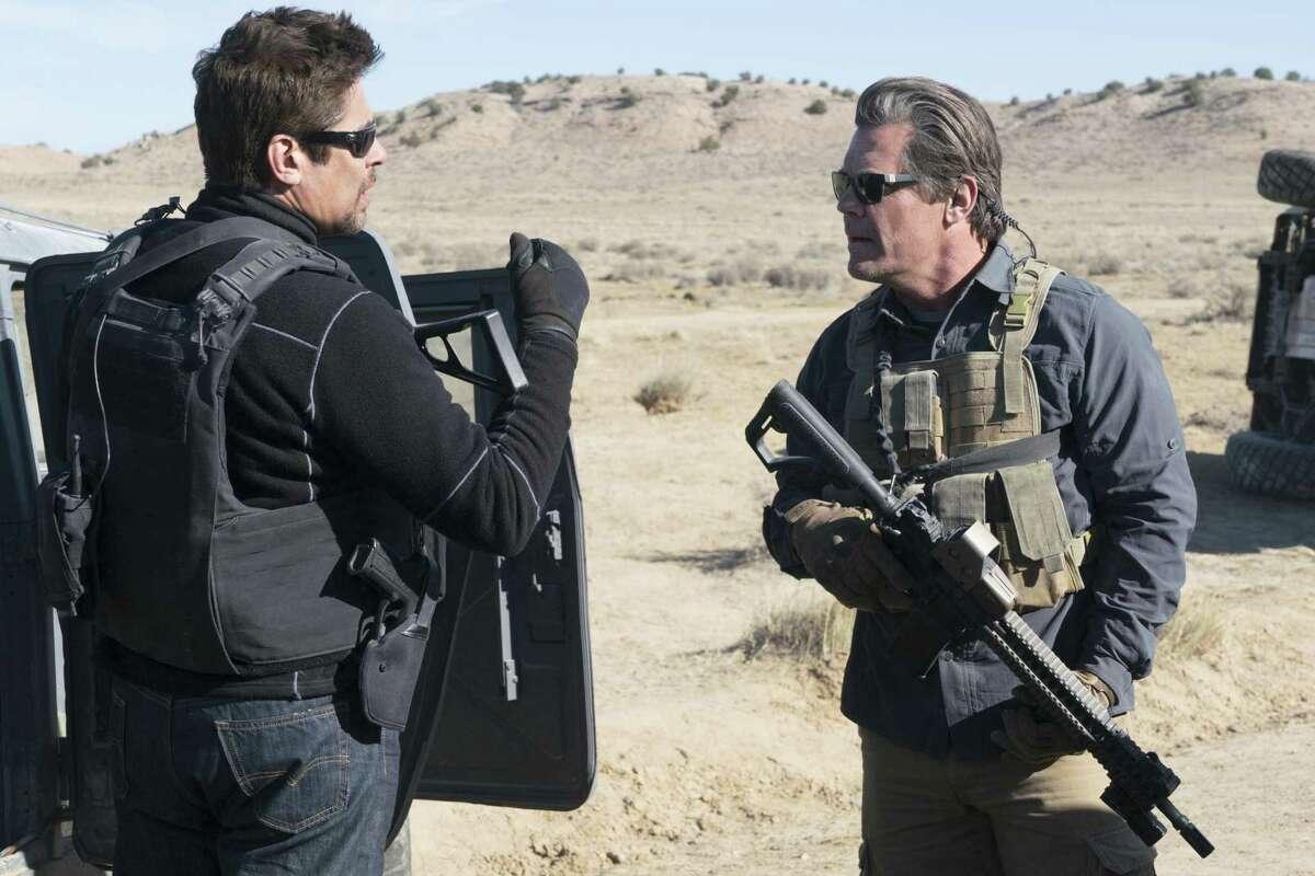 Benicio Del Toro (left) is a Mexican assassin and Josh Brolin is a CIA operative in
