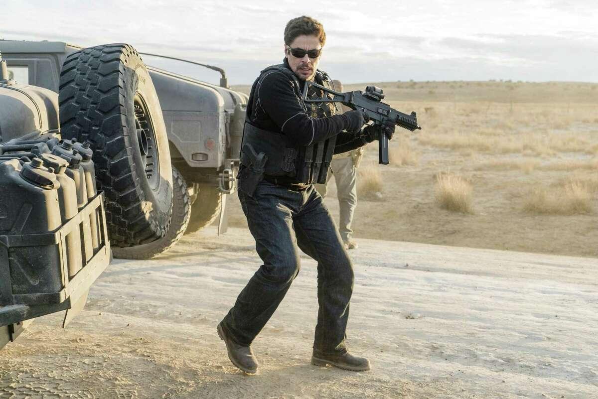 Benicio Del Toro carries