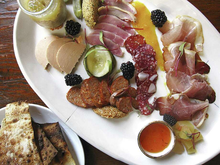 Charcuterie plate with foie gras, apple-jalapeño pork rillette, duck ham, lamb-and-fennel salami, lamb chorizo and 9-month speck with beer crackers, jams and mustards from Cured. Photo: Mike Sutter /San Antonio Express-News