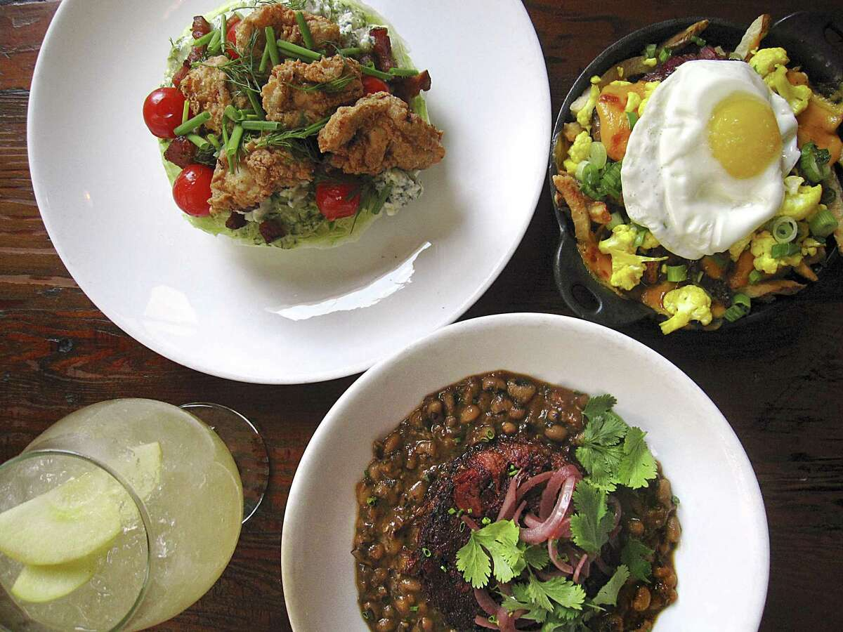 The menu at Cured might include food as diverse as a fried oyster iceberg salad with blue cheese, pig cheek poutine with a fried egg, shredded lamb shank with black-eyed peas and a non-alcoholic apple caraway fizz.