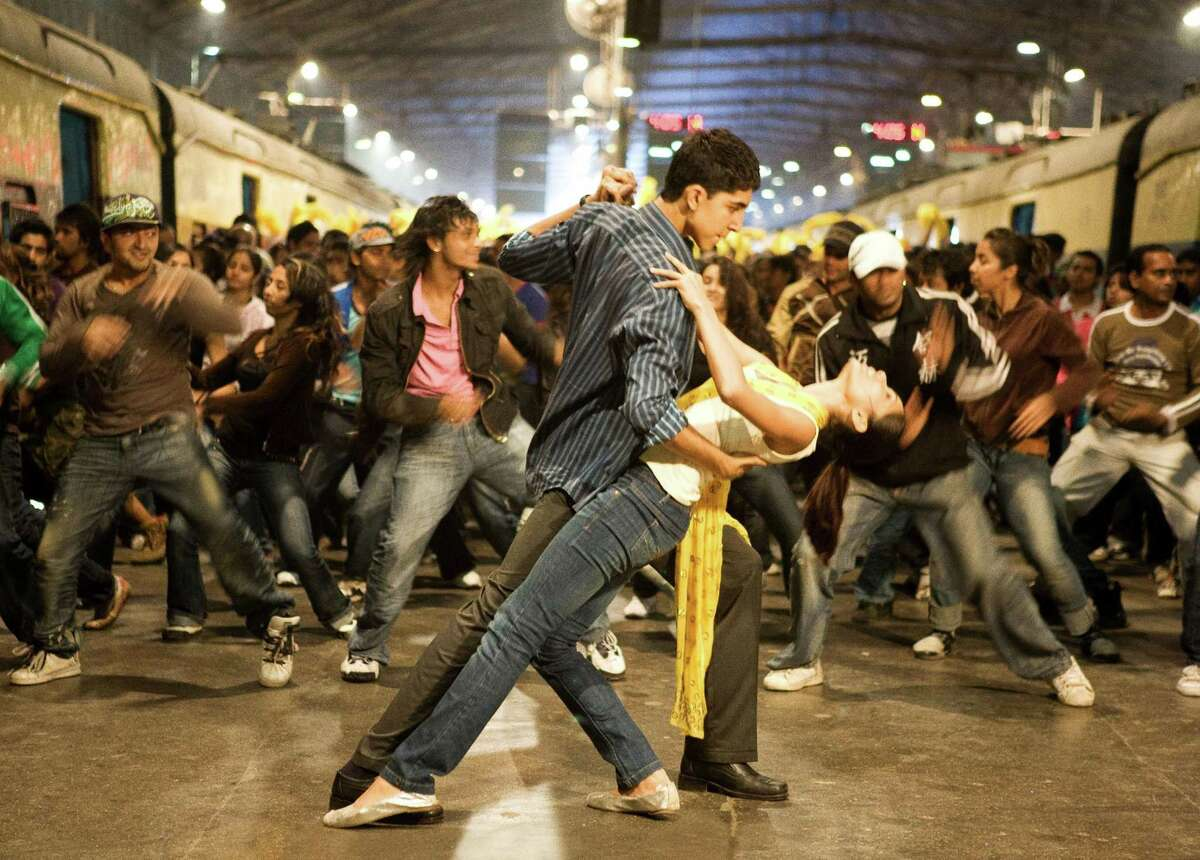 """This image provided by Fox Searchlight shows the closing credits dance scene with Dev Patel as """"Jamal"""" and Freida Pinto as """"Latika"""" in """"Slumdog Millionaire."""" The longshot story of Jamal Malik in """"Slumdog Millionaire"""" mirrors the uphill struggle to make the movie as well. But amid the current credit crisis and slumping DVD market, today it might not get made at all. (AP Photo/Fox Searchlight) ** NO SALES **"""