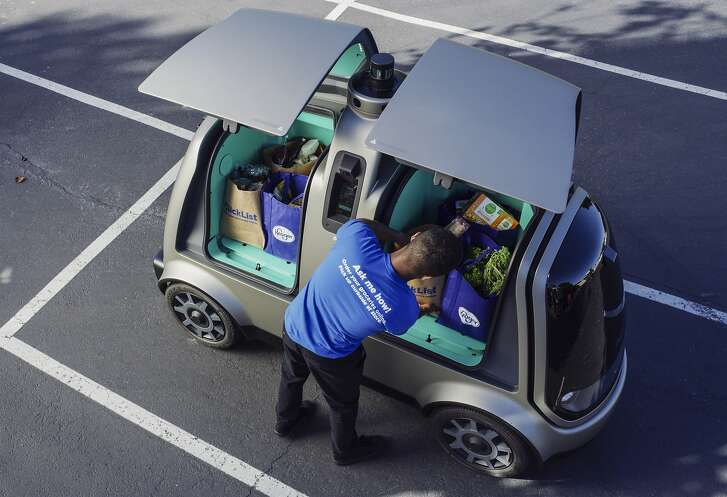This undated photo provided by The Kroger Co. shows a driverless car that the Cincinnati-based company is about to test whether it can steer supermarket customers away from crowded grocery aisles with a fleet of diminutive driverless cars designed to lower delivery costs. The test program announced Thursday, June 28, 2018, could make Kroger the first U.S. grocer to make deliveries with robotic cars that won�t have a human riding along to take control in case something goes wrong. (Andrew Brown/The Kroger Co. via AP)