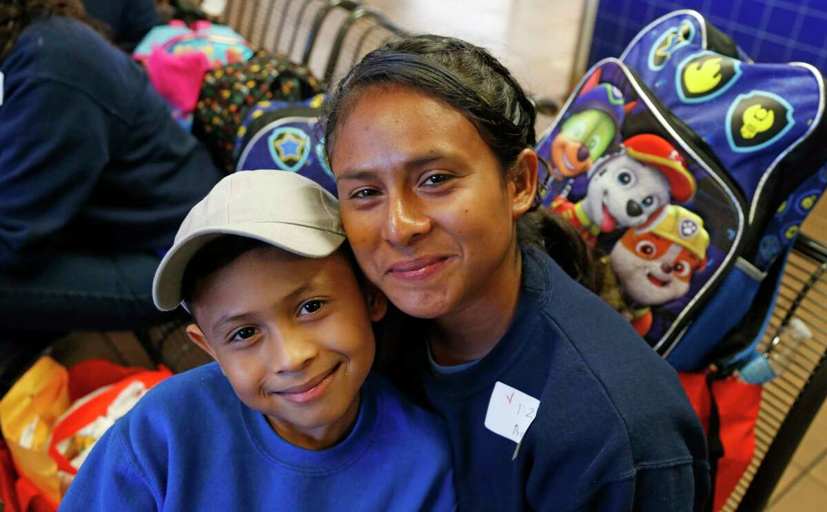 A young mother and her son requested a photo taken of them after they had received their care package from Joshua R. Norman. NFL player Joshua R. Norman of the Washington Redskins joined his friend Demario Davis today to distribute backpack care packages to families released from the South Texas detention centers. Immigrants from Mexico and Central America who normally travel on buses from San Antonio are headed across the country to relatives or sponsors as their immigration on Wednesday, June 27,2018.