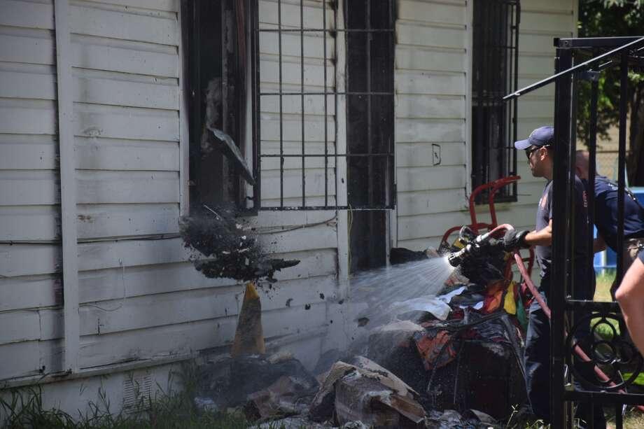 Firefighters respond to a blaze in the 3700 block of San Fernando Street on Thursday, June 28, 2018. Photo: Caleb Downs / San Antonio Express-News