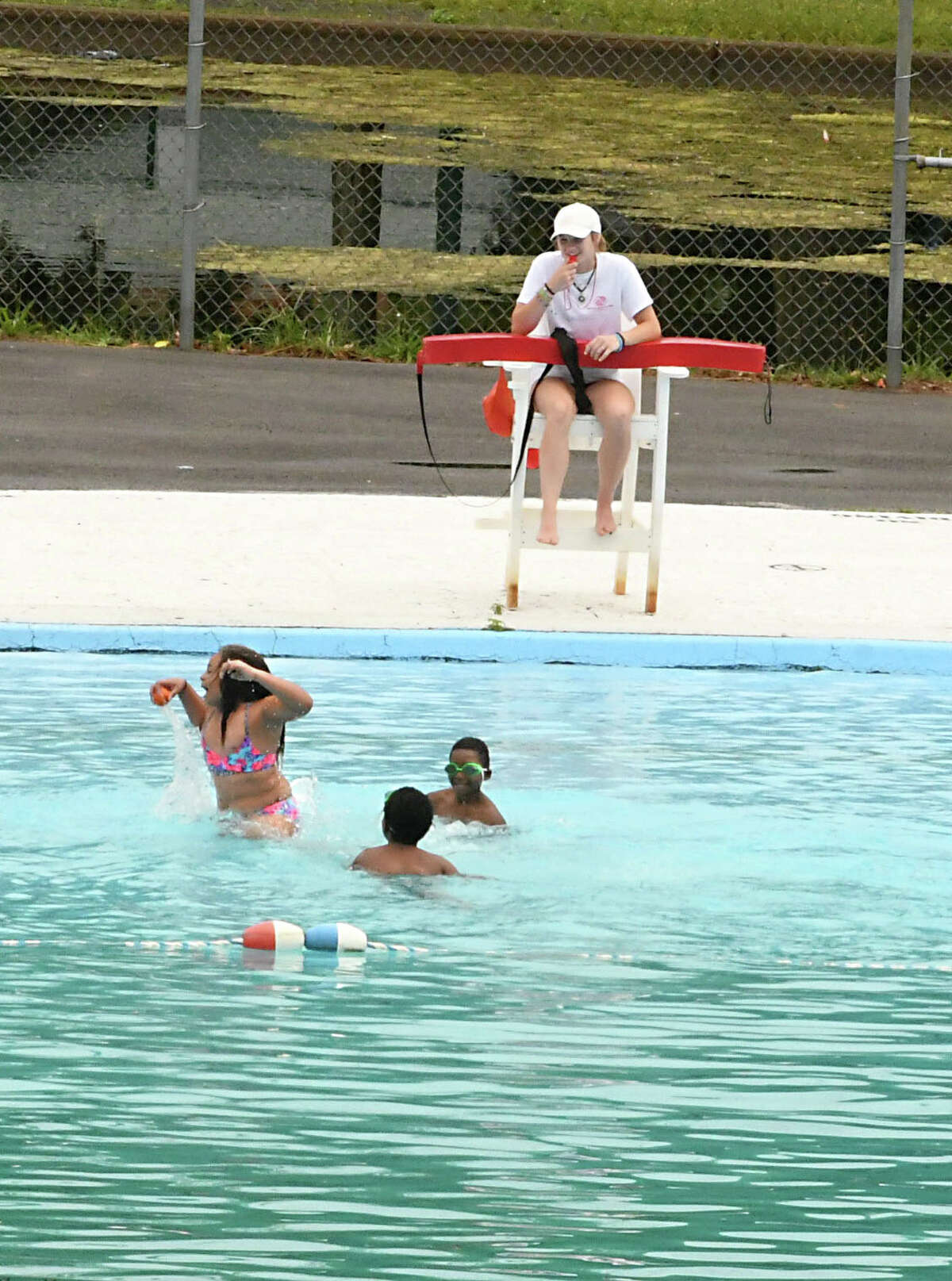 A lifeguard keeps an eye on children swimming in the pool at Central Park on Thursday, June 28, 2018 in Schenectady, N.Y. Today starts a stretch of hot and humid weather. (Lori Van Buren/Times Union)