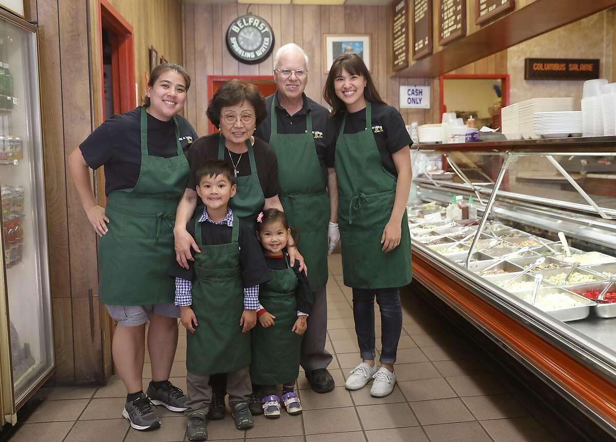 Family left to right--Rhonda Ramos, Jean Aburahma with her grand children Caleb Cheng, 4 1/2 years old and Abigail Cheng, 2 1/2 years old, Mike Abraham, and Rema Cheng pose at Turk & Larkin Delion Monday, June 25, 2018, in San Francisco, Calif. Mike and Jean Aburahma opened the deli almost forty years ago.