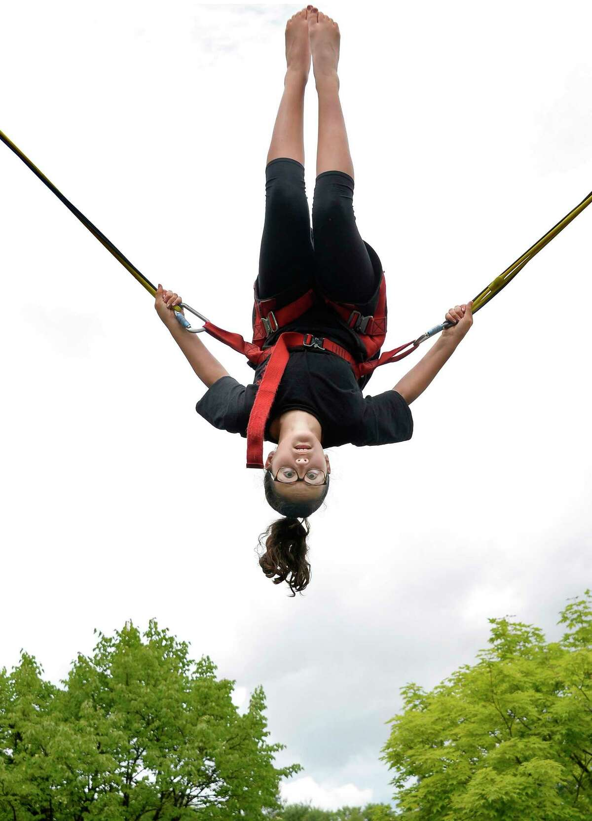 Ten-year-old Ali Palleschi of Rotterdam gets upside down on the Sky Launcher at FunPlex Action Park Thursday June 28, 2018 in East Greenbush, NY. (John Carl D'Annibale/Times Union)