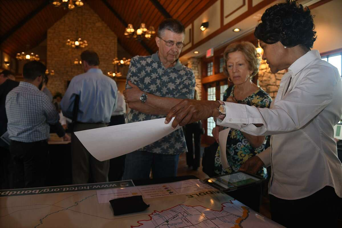 Tojuana Cooper, right, a Harris County Flood Control District Professional Engineer, describes one of the Spring Creek 2018 Bond Project proposals to Audabon Grove residents David and Barbara Tomaja, from left, during the HCFCD Bond Program Information & Community Engagement meeting at the Big Stone Lodge At Dennis Johnston Park in Spring on June 27, 2018. (Jerry Baker/For the Chronicle)