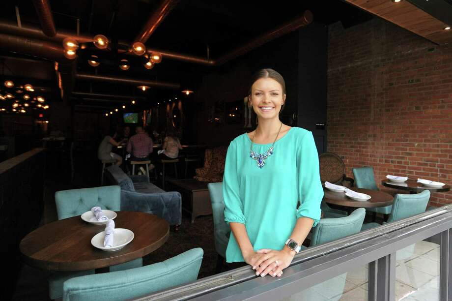Hannah Hartell, director of sales and marketing for Bedford Hall Craft Kitchen and Bar, poses for a photo inside the new restaurant at 135 Bedford St., in downtown Stamford, Conn., on Wednesday, June 27, 2018. Photo: Michael Cummo / Hearst Connecticut Media / Stamford Advocate