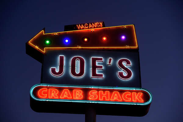 A neon sign at Joe's Crab Shack in Beaumont.  Photo taken Tuesday 6/26/18 Ryan Pelham/The Enterprise