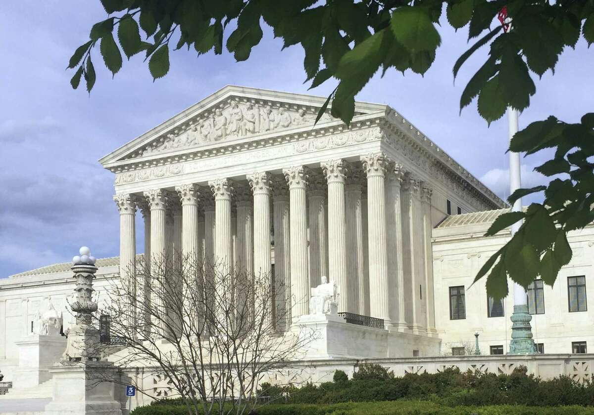 FILE - This April 23, 2018, file photo shows the Supreme Court in Washington. Supreme Court Justice Anthony Kennedy is stepping down, giving President Donald Trump a shot at remaking the high court into its most conservative version in decades when he names a replacement. (AP Photo/Jessica Gresko, File)