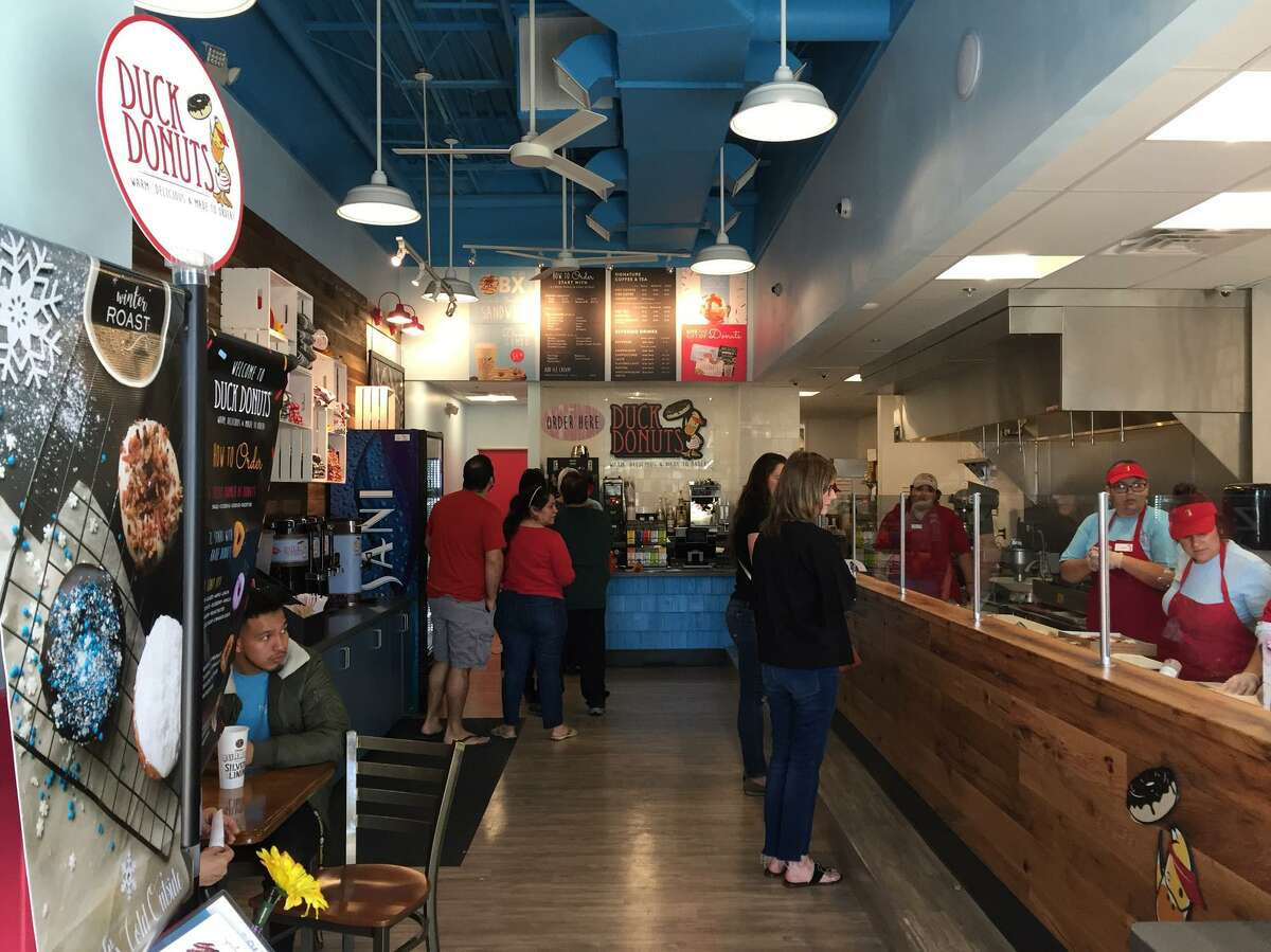 Customers line up for fresh customized doughnuts at Duck Donuts.