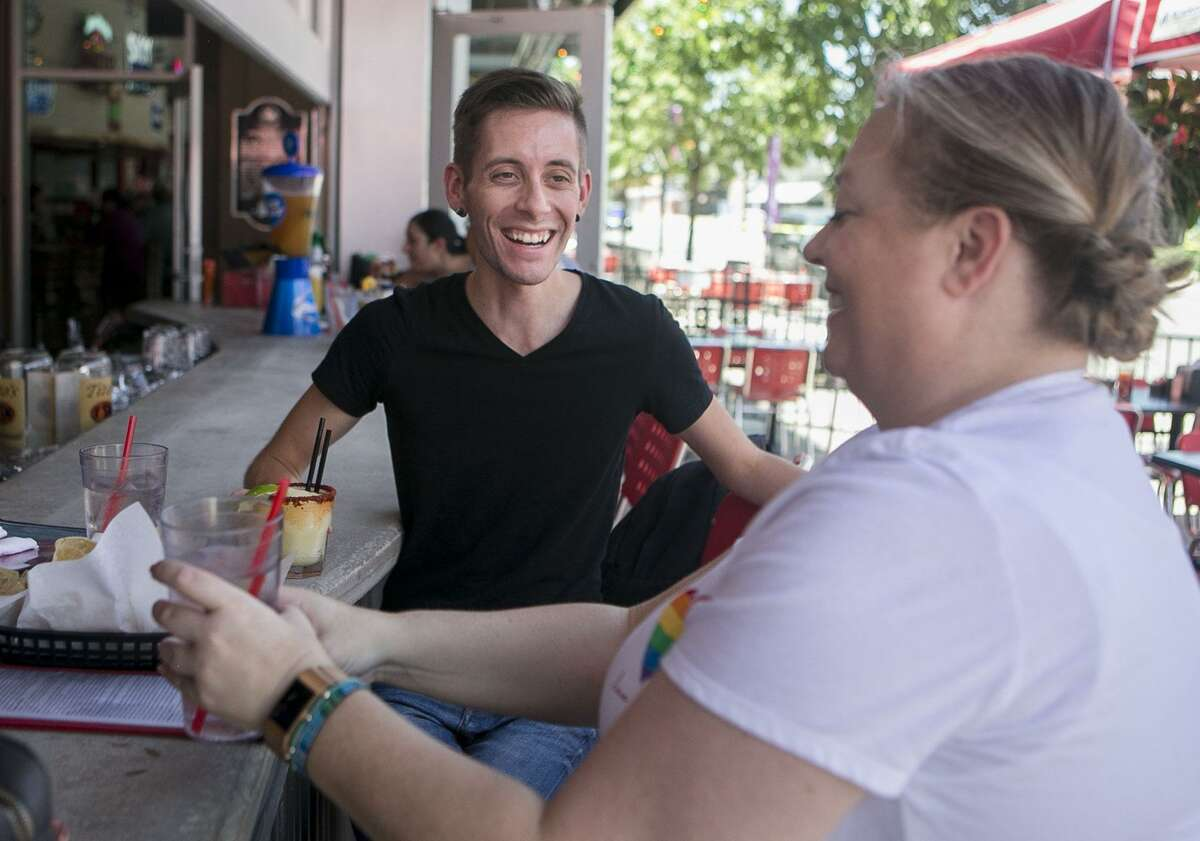 Ron Minard shares a laugh with Jennifer Boswell during happy hour at Luther's Cafe.