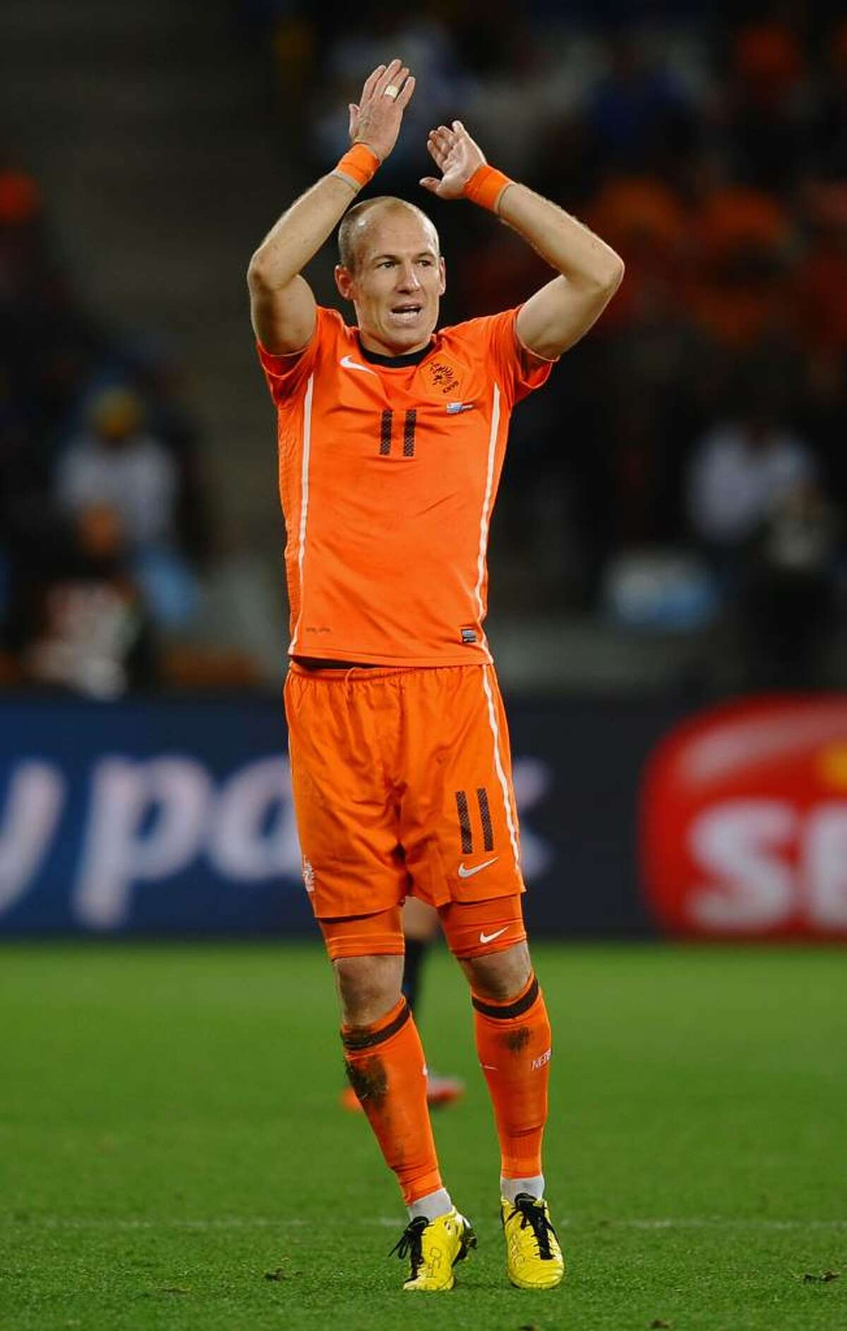 CAPE TOWN, SOUTH AFRICA - JULY 06: Arjen Robben of the Netherlands celebrates during the 2010 FIFA World Cup South Africa Semi Final match between Uruguay and the Netherlands at Green Point Stadium on July 6, 2010 in Cape Town, South Africa. (Photo by Laurence Griffiths/Getty Images) *** Local Caption *** Arjen Robben