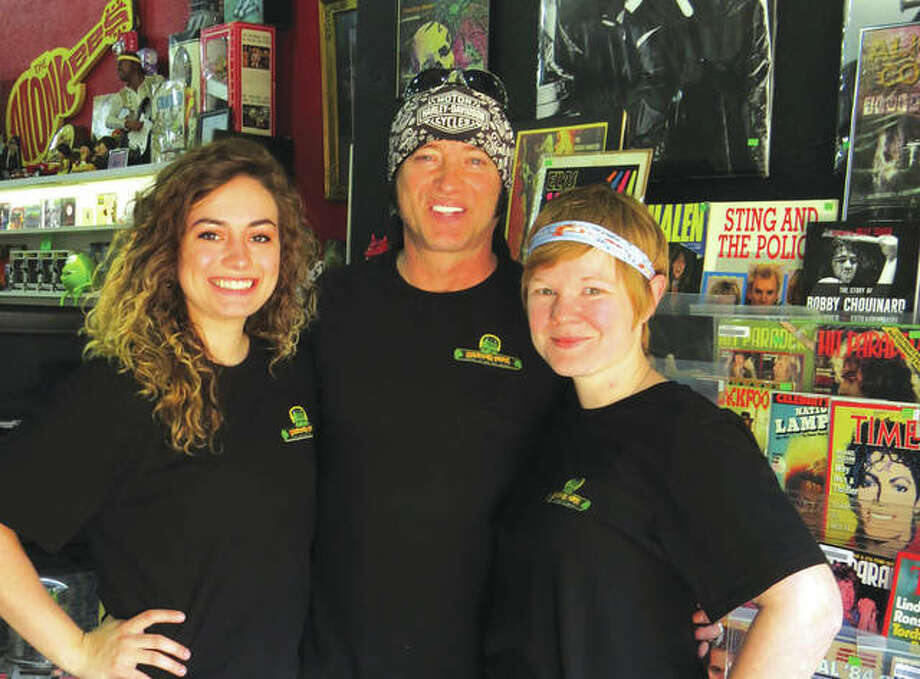 Sydney Mason, Bill Cherry, and Sara Cooper at Monster Vinyl. Cherry owns the record and collectible store, Mason is his fiance and Cooper is the store manager. Photo:       Carol Arnett/The Edge