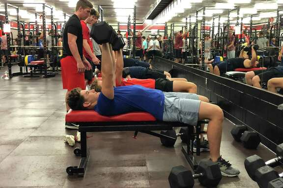 Hargrave High School boys perform chest press reps at Falcon Athletic Trainng Camp on June 26.