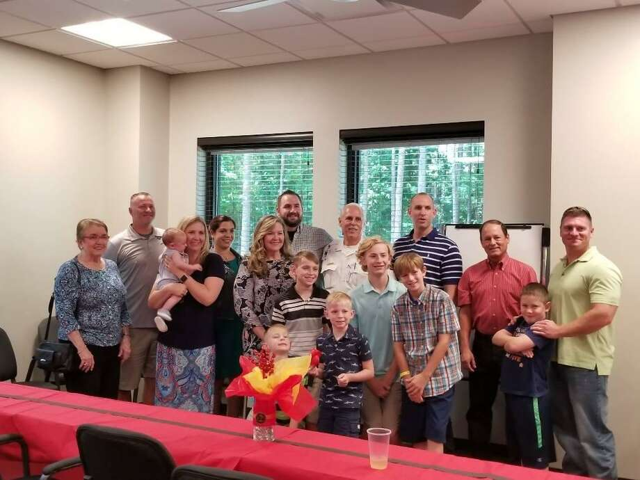 South Montgomery County Fire Department Deputy Chief Tommy Erickson, center, surrounded by family members during his retirement party on Tuesday, June 26, 2018. Photo: South Montgomery County Fire Department
