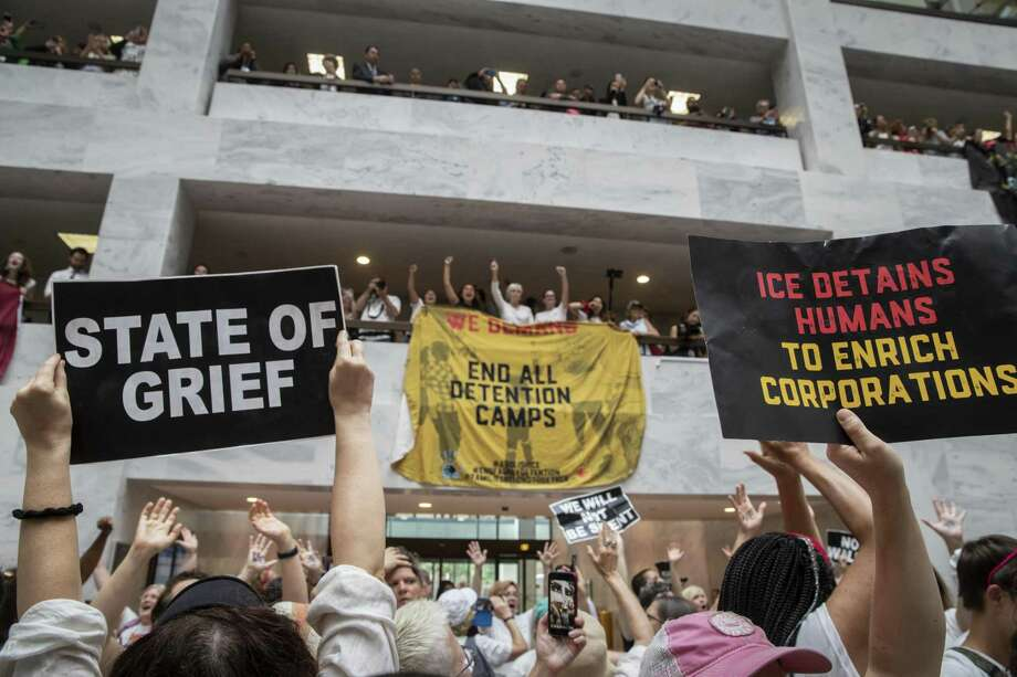 Hundreds of activists protest the Trump administration's approach to illegal border crossings and separation of children from immigrant parents, in the Hart Senate Office Building on Capitol Hill in Washington on June 28. Photo: J. Scott Applewhite / Associated Press / Copyright 2018 The Associated Press. All rights reserved