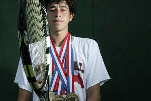 Memorial High School 2018 senior Andrew Esses poses for a photo at the school's tennis courts onThursday, June 7, 2018 in Houston. Esses was named All Greater Houston  Male Tennis Player of the Year for 2018.