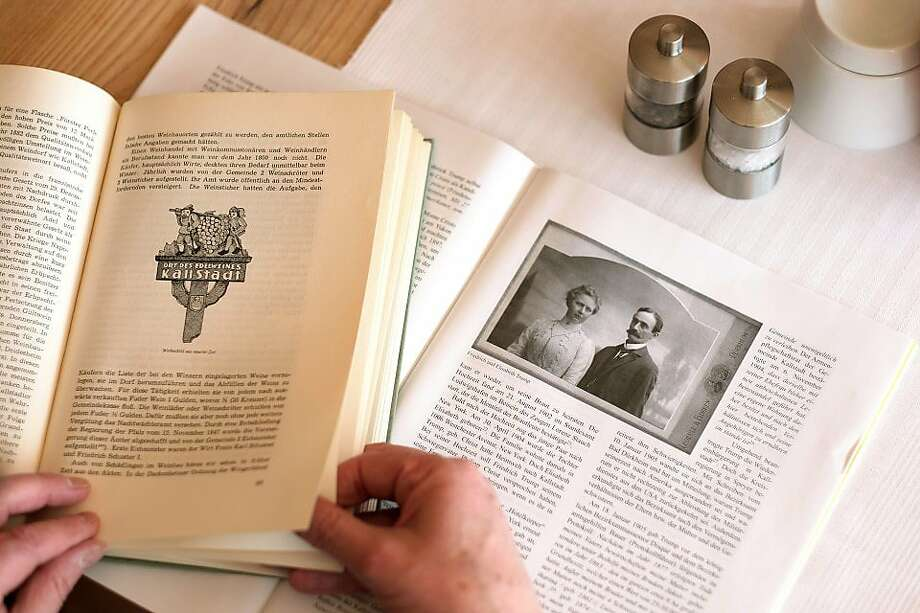 Friedrich Trump and Elizabeth Trump, President Donald Trump's grandparents, are shown in a journal being reviewed by historian Roland Paul in Kallstadt, Germany, on March 29, 2016.  Photo: Bonnie Jo Mount, The Washington Post