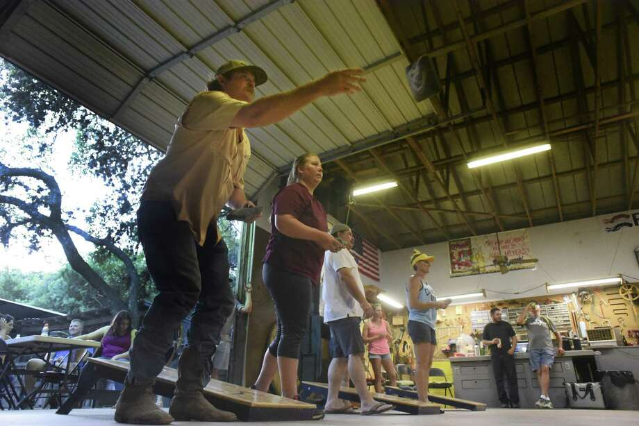 Know your cornhole basics. Cornhole is played in frames or innings. Each player or team tosses four cornhole bags. The target is a 6-inch hole at the far end of a raised platform called a cornhole board. A bag in the hole scores 3 points, while a bag on the board gets 1 point.