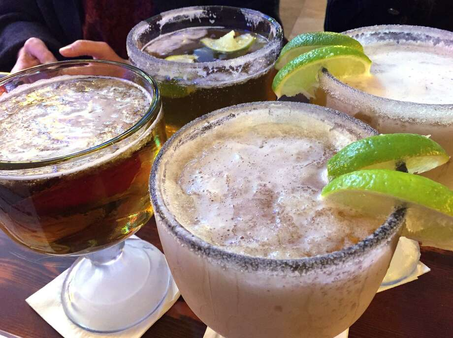 A quartet of frosty schooners filled with beer from M.K. Davis Restaurant & Bar. Photo: Paul Stephen /San Antonio Express-News