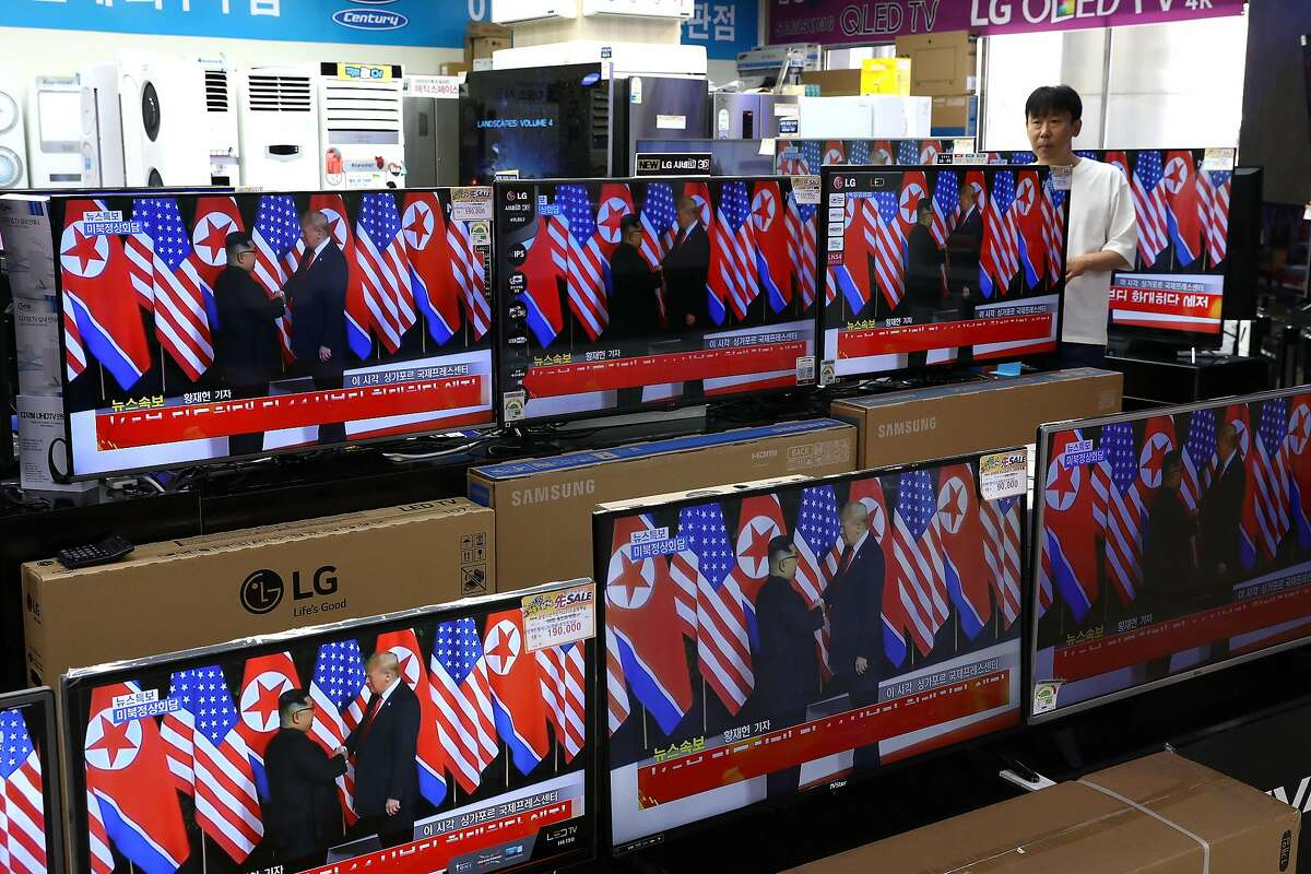 SEOUL, SOUTH KOREA - JUNE 12: U.S. President Donald Trump meeting with North Korean leader Kim Jong-un is shown on television screens at an electronics retail store on June 12, 2018 in Seoul, South Korea. U.S. President Donald Trump and North Korean leader Kim Jong-un held the historic meeting on Tuesday morning in Singapore, carrying hopes of ending decades of hostility and the threat of North Korea's nuclear program. (Photo by Chung Sung-Jun/Getty Images)