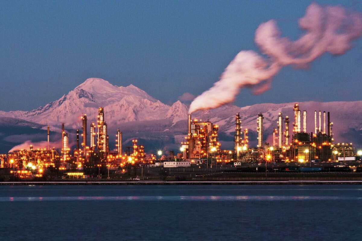 The Anacortes refinery of former San Antonio-based refiner Andeavor, now owned by Marathon Petroleum Corp., is pictured against Mount Baker in Washington state. Before it was bought Andeavor had contributed millions of dollars to a campaign against Initiative 1631, a carbon fee that Washingtonians will vote on on November.