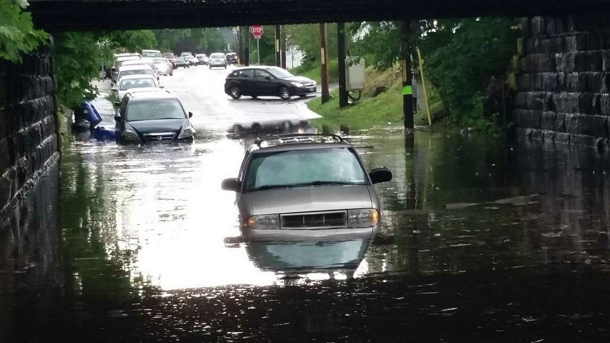 A sudden thunderstorm Thursday afternoon trapped motorists in their cars when East Avenue flooded.