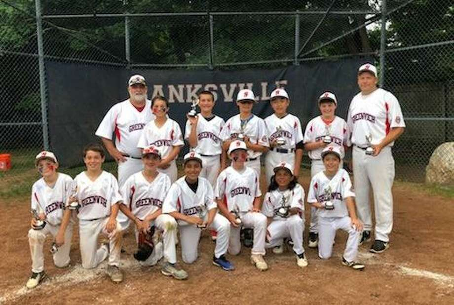 The Greenwich Cal Ripken 11-under All-Star baseball team won the District 1 Tournament on Wednesday with an 8-5 victory over New Canaan. The championship team included, front row from left to right: Tim McGrath, Matthew Maloney, Tripp Beasley, Michael McClammy, Troy Goodwin, Raymond Perez and Matthew Buckingham. Back row from left to right: coach Tom Beasley, Joey Abbazia, Max Marek, Nolan Cracraft, Kairi Koike, Danny Vartuli and coach Tom McGrath. Coach Joe Abbazia, Brian Murphy and Jake Murray are not pictured. Photo: Contributed Photo / Stamford Advocate Contributed