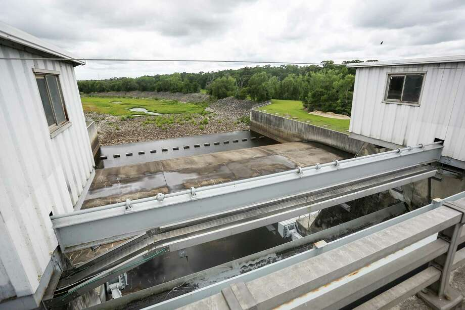 A view from the dam gates bridge of the Lake Conroe Dam is pictured on Monday, June 18, 2018. Photo: Michael Minasi, Staff Photographer / Houston Chronicle / © 2018 Houston Chronicle