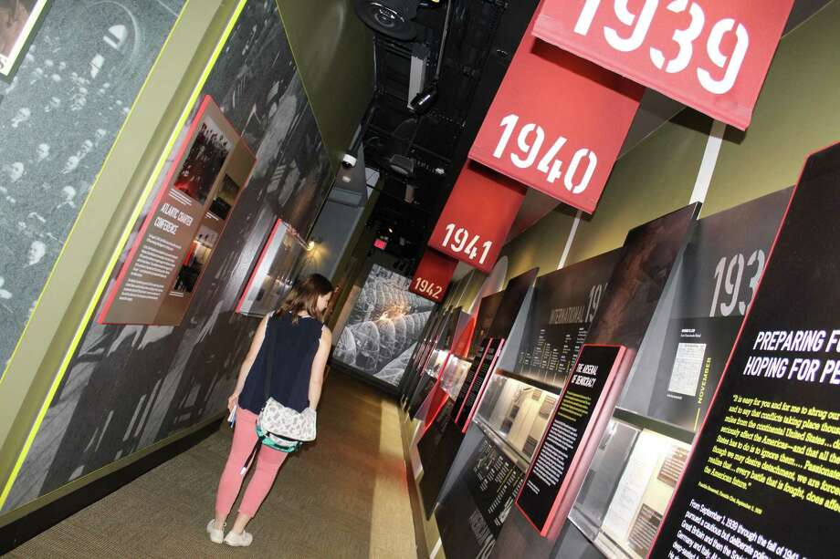 Reporter Sophie Vaughn observes a timeline of World War II at the Franklin D. Roosevelt Museum in Hyde Park, New York. Photo: Pat Tomlinson / Hearst Connecticut Media