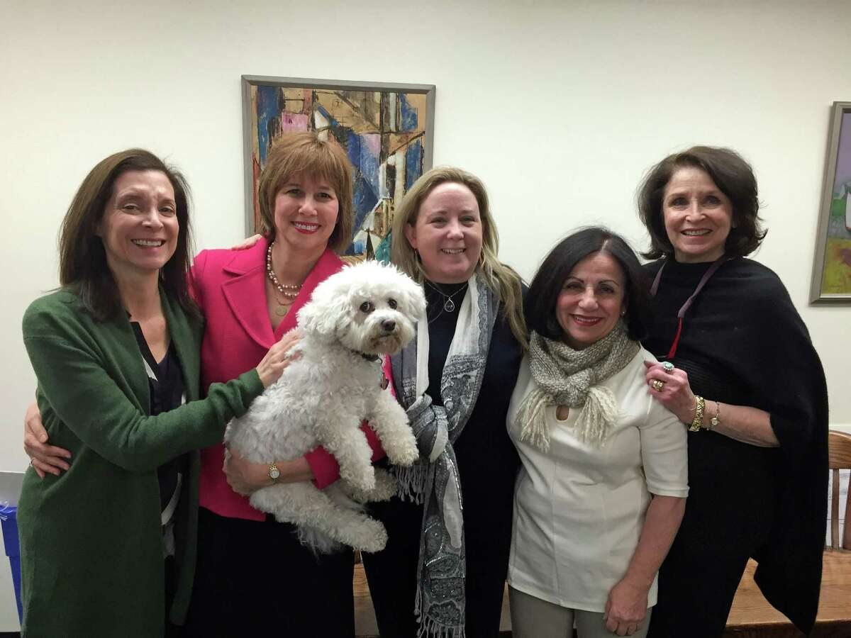 """From left, Westport resident Jane Sklar, Probate Court Judge Lisa Wexler and dog """"Sugar,"""" Weston Republican Town Committee Chairwoman Britta Lerner, State Sen. Toni Boucher, and Westport resient Ellen Strauss joined with about 20 other state and local officials, friends and family to witness the swearing in of Wexler as the Westport-Weston District probate judge in 2015."""