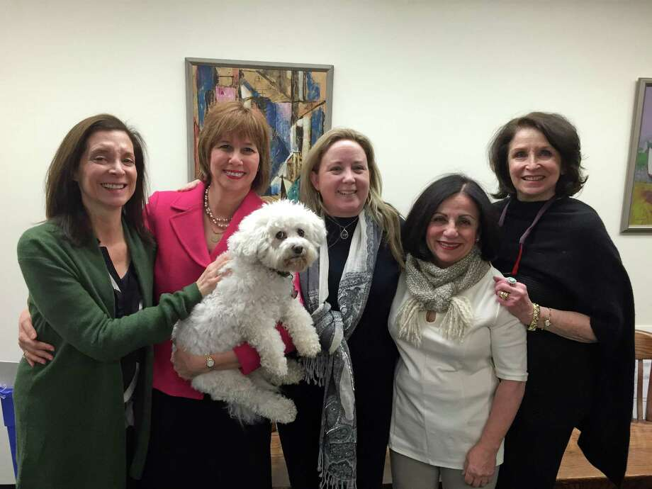 "From left, Westport resident Jane Sklar, Probate Court Judge Lisa Wexler and dog ""Sugar,"" Weston Republican Town Committee Chairwoman Britta Lerner, State Sen. Toni Boucher, and Westport resient Ellen Strauss joined with about 20 other state and local officials, friends and family to witness the swearing in of Wexler as the Westport-Weston District probate judge in 2015. Photo: Contributed Photo / Contributed Photo / Connecticut Post Contributed"