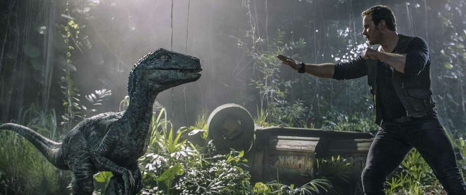 "This image released by Universal Pictures shows Chris Pratt in a scene from ""Jurassic World: Fallen Kingdom."" Photo: Universal Via AP / COPYRIGHT © 2018 UNIVERSAL STUDIOS and AMBLIN ENTERTAINMENT, INC. and LEGENDARY PICTURES PRODUCTIONS, LLC."